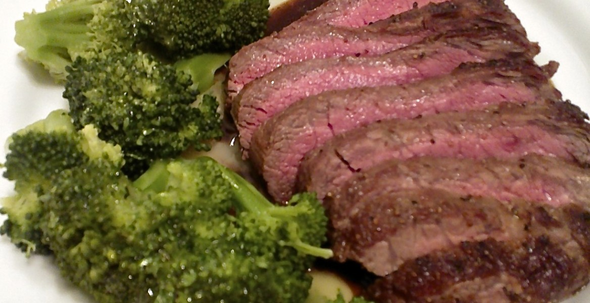 Sliced blade steak on cognac/worcestershire reduction, steamed broccoli with parsley beurre blanc